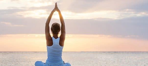 woman doing yoga 604x270 1